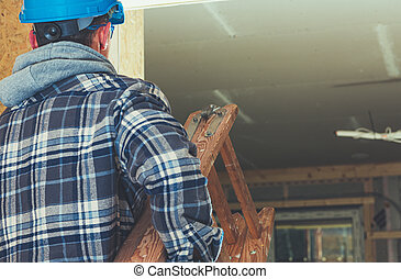 Construction Worker with Wooden Ladder in His Hands