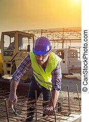Construction worker working on reinforcement mesh