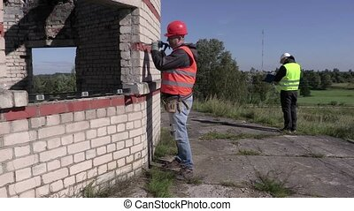 Construction worker working with chisel and hammer