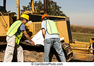construction workers and bulldozer