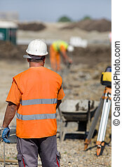 Construction workers at building site - Construction workers...