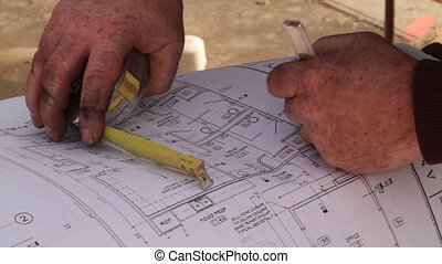 construction workers consult blueprints
