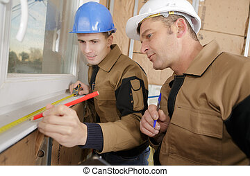 construction workers fitting windows