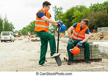 Construction workers having break
