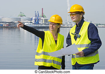 Construction workers in harbor - Female project engineers...