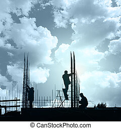 Construction workers in preparation for binding rebar , heavy industry concept