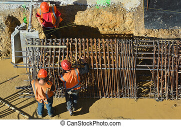 Construction workers making reinforcement - Aerial top view ...