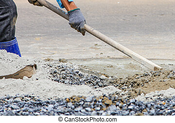 construction workers mixing cement