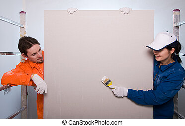 Construction workers painting