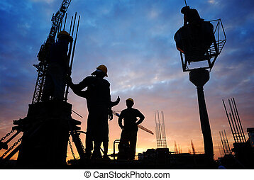 construction workers - silhouette of construction worker on...
