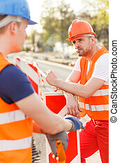 Construction workers smoking cigarette