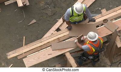 Construction workers take measurements