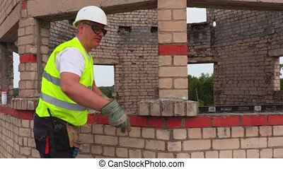 Construction workers throwing bricks