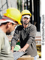 Construction workers - Two authentic construction workers,...