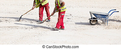 Construction workers with shovel
