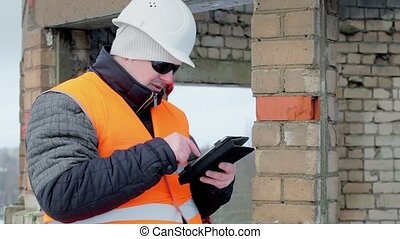 Construction workers with tablet PC