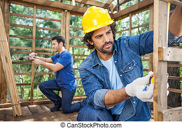 Construction Workers Working At Construction Site - Male...