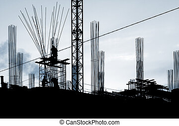 Construction works: silhouettes of 3 workers