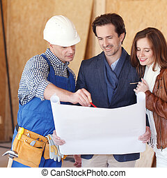 Couple Look At Home Plans