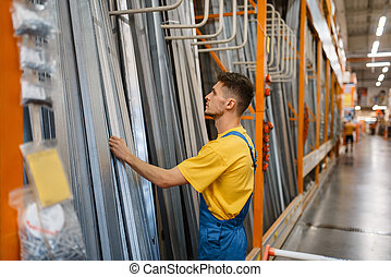 Constructor choosing materials in hardware store