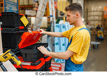 Constructor choosing toolbox in hardware store