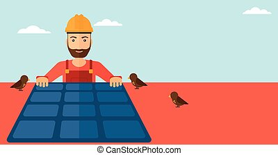 Constructor with solar panel. - A hipster man with the beard...