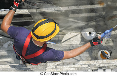 Constructor worker on scaffolding