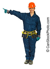 Constructor worker woman pointing - Full length of smiling...