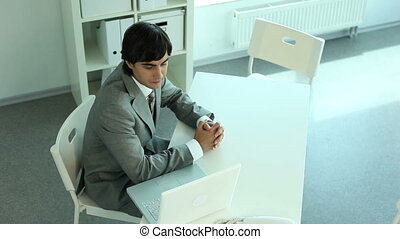 Consultancy - Two woman sitting down at a manager and he is...