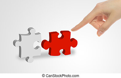 A person connecting to pieces of a puzzle.