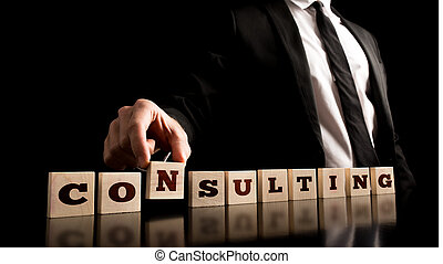 Consultant Arranging Wooden Pieces with ConsultingText -...