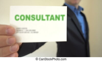 Consultant Present Business Card - Shot of Consultant...