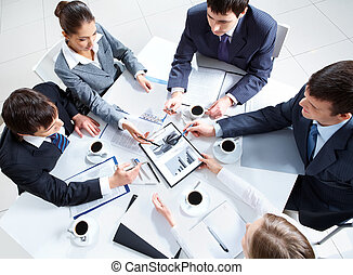 Consultation - Above view of business team discussing papers...