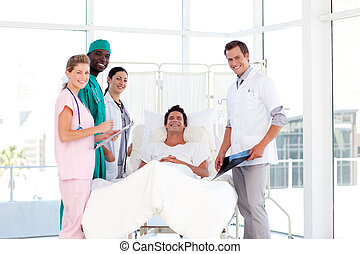 Consultation between doctors and a patient