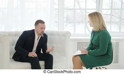 Consultation of a psychologist. Male psychologist consults...