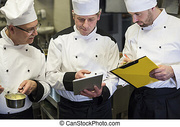 Consultation of chefs in the kitchen