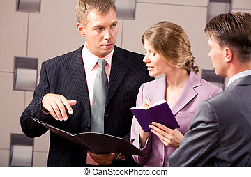 Consulting - Confident businessman explaining his viewpoint...