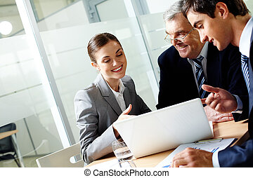 Consulting in office - Successful businessteam of three ...