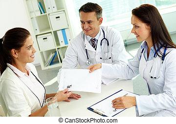 Consulting patient - Portrait of confident practitioner ...