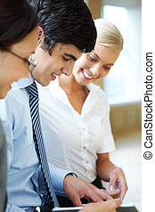 Consulting - Portrait of busy companions discussing new...