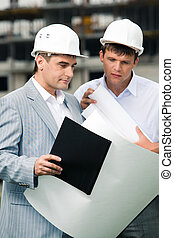 Consulting - Portrait of business partners looking at new...