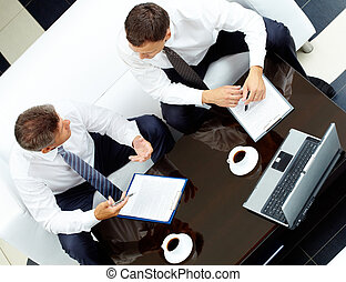 Consulting - Image of two business partners discussing work...