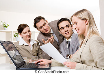 Consulting - Portrait of friendly workteam looking at...