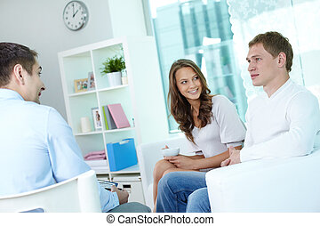 Consulting - Young couple consulting with financial adviser...