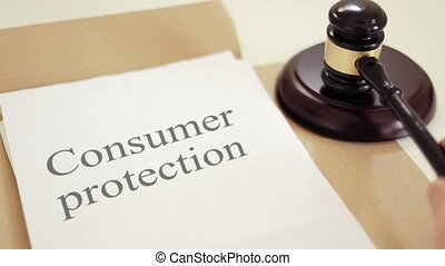 Consumer protection written on legal documents with gavel