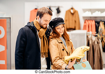 consumering, shopping concept. couple is shopping