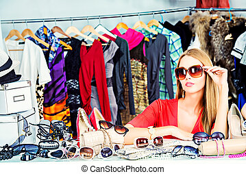 consumerism - Fashionable girl shopping in a store.