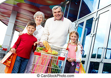 Consumers - Portrait of happy grandparents and grandchildren...