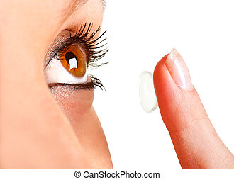Contact Lens - Closeup of a woman inserting a contact lens...