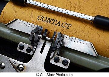 contact, machine écrire
